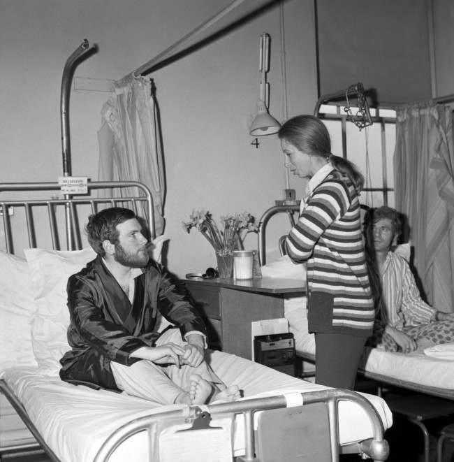 Princess Anne talks to PC Michael Hills, who was injured during Ian Ball's attempt to kidnap Princess Anne in Pall Mall. 923-Archive-pa165834-65 Ref #: PA.19319596 Date: 25/03/1974