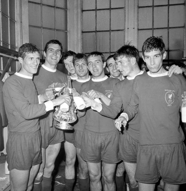 Liverpool celebrate their FA Cup Final victory in milk in the Wembley dressing room. Left to Right: Stevenson, Yeats (captain), Lawler, Hunt, Thompson, Byrne, Smith and Strong.
