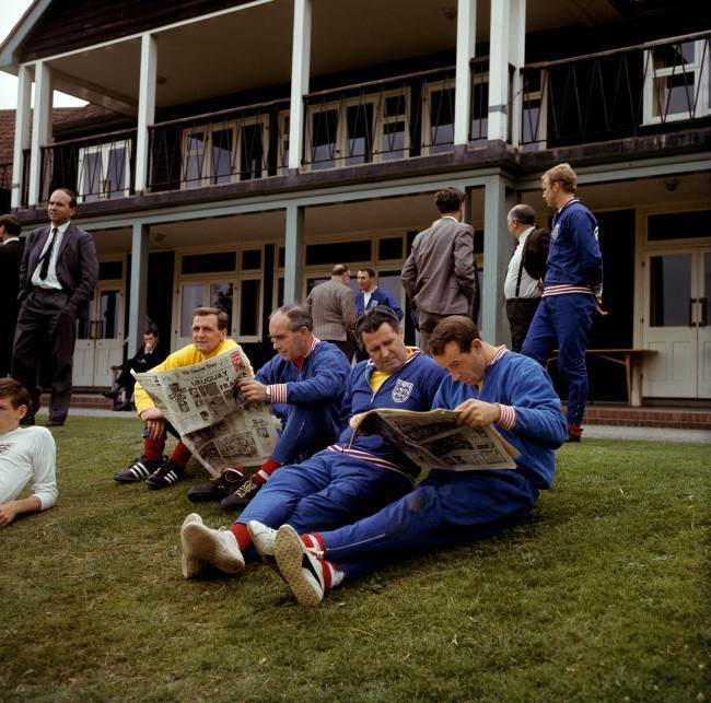 (L-R) England trainer Les Cocker, manager Alf Ramsey, physio Harold Shepherdson and Jimmy Greaves read the morning newspapers during a relaxing training session at Roehampton Ref #: PA.2219402  Date: 15/07/1966