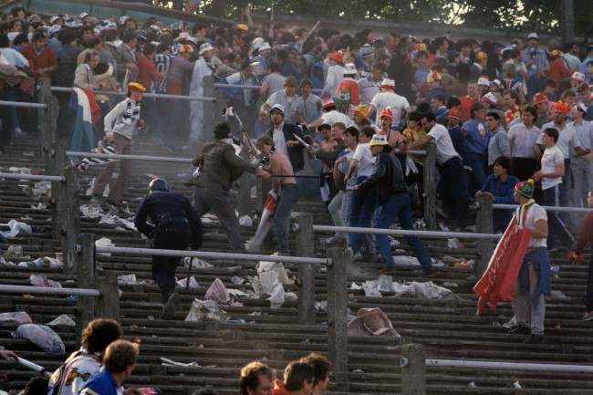 European Cup - Final - Liverpool v Juventus - Heysel Stadium Chaos erupts on the terraces as a single policeman tries to prevent Liverpool and Juventus fans getting stuck into each other Date: 29/05/1985