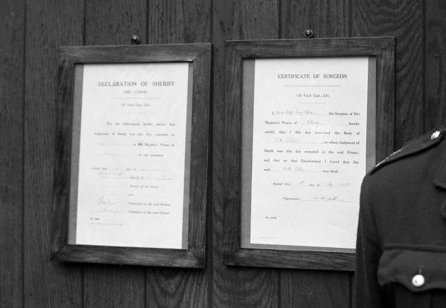 The notices of Sheriff and Surgeon, announcing the execution of Mrs Ruth Ellis, are posted on the gates of Holloway Prison.