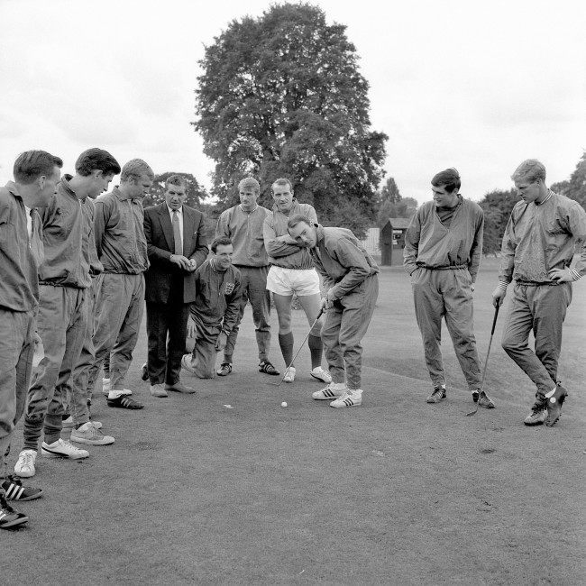 England's Jimmy Greaves (third r) lines up a putt as he and his teammates take a break from the serious business of preparing for the World Cup Final. Looking on are (l-r) trainer Les Cocker, Peter Bonetti, Bobby Moore, ?, Jimmy Armfield, Roger Hunt, Ron Springett, Norman Hunter and Ron Flowers Ref #: PA.2494092  Date: 29/07/1966