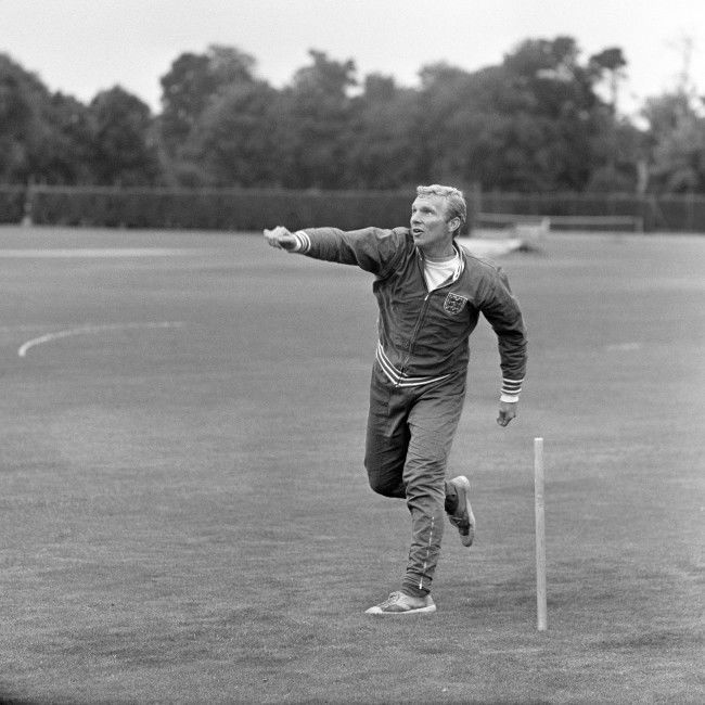 England captain Bobby Moore turns his arm over as the players relax with a game of cricket Ref #: PA.2507799  Date: 15/07/1966