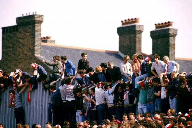 Southampton fans sit on a wall to get the best view at Highbury