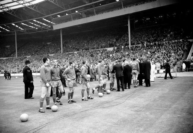 The Liverpool team are introduced to the assembled dignitaries before the match