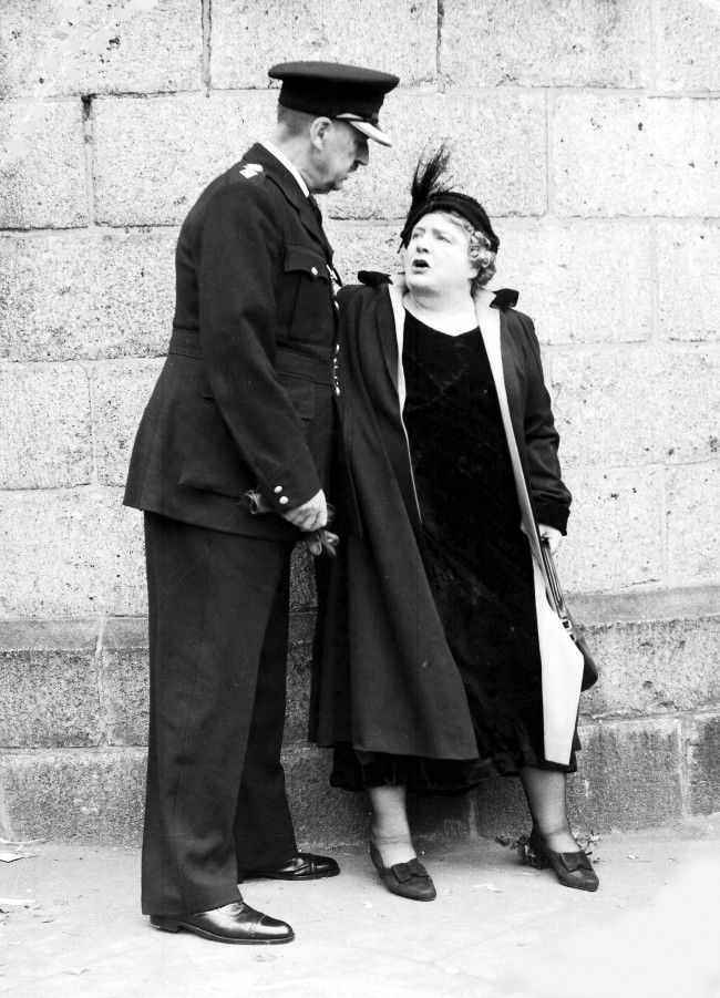 Abolition of capital punishment agitator Violet van Der Elst argues with a police officer outside Holloway Prison, London, July 13, 1955, after she had protested against the execution of Ruth Ellis for murder.