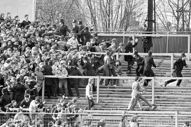 Soccer - FA Cup - Fifth Round - Chelsea v Liverpool - Stamford Bridge Police try to hold back Chelsea fans as they surge across the terraces towards opposing Liverpool fans. Date: 13/02/1982