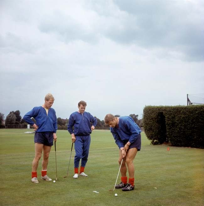 England's Roger Hunt putts watched by Ron Flowers and John Connelly (C) at Roehampton Archive-900-76 Ref #: PA.5136490  Date: 29/07/1966