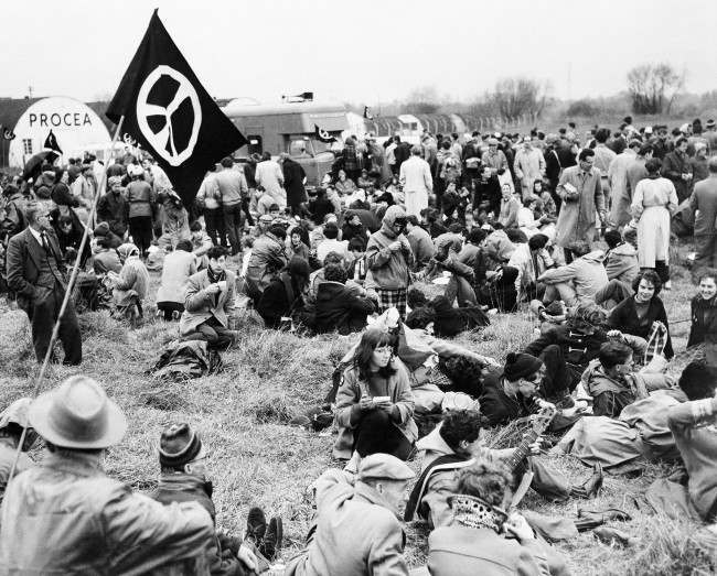 Marchers protesting nuclear bomb tests rest in a field near airport in London March 30, 1959.