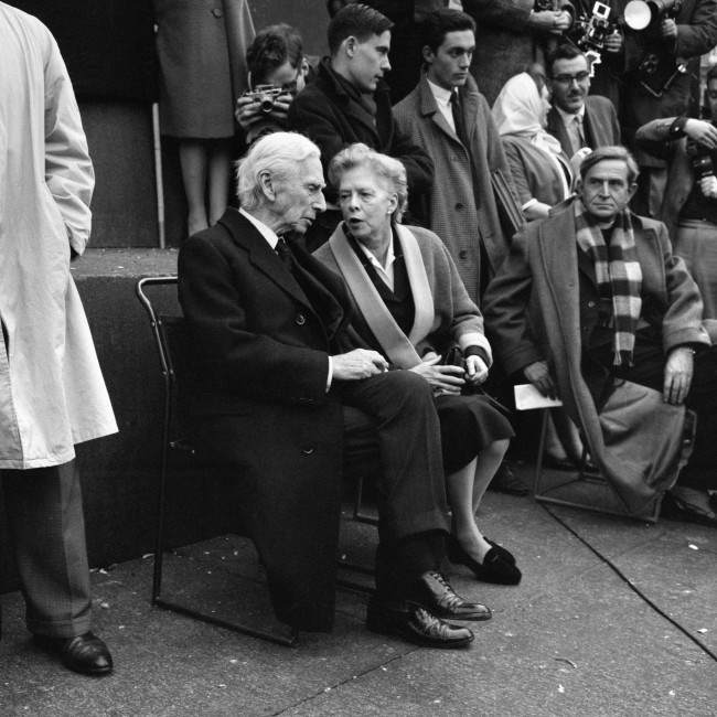 Lady Russell has a word with Earl Russell on the plinth of Nelson's Column when they attended a meeting held by the Committee of 100, the anti-bomb organisation, in Trafalgar Square, London, to explain the Committee's aims and principles.