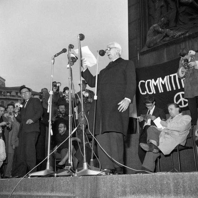 Earl Russell speaking from the plinth of Nelson's Column when he attended a meeting held by the Committee of 100, the anti-bomb organisation, in Trafalgar Square, London, to explain the Committee's aims and principles. Ref #: PA.6739950  Date: 29/10/1961