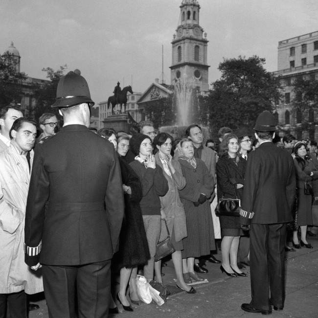 Police keep a respectful presence at the protest meeting in Trafalgar Square organised by The Committee of 100. The crowd are listening intently as one of the founders of the movement, the philosopher Earl Russell, was speaking. Ref #: PA.6739960  Date: 29/10/1961