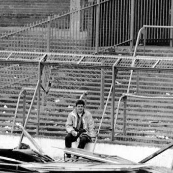 Hillsborough In Photos: A Lone Liverpool Fan Sits On The Broken Terraces