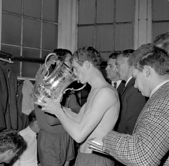 Liverpool's Wilf Stevenson drinks from the FA Cup in the dressing room after his team's 2-1 win