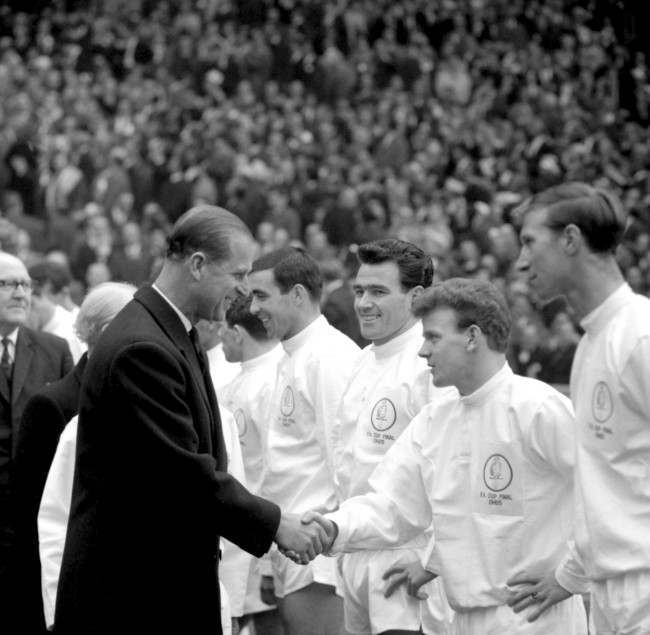 HRH The Duke of Edinburgh shakes hands with Leeds United's Billy Bremner (second r) before the match as Leeds' Jack Charlton (r) and Jim Storrie (third r) look on