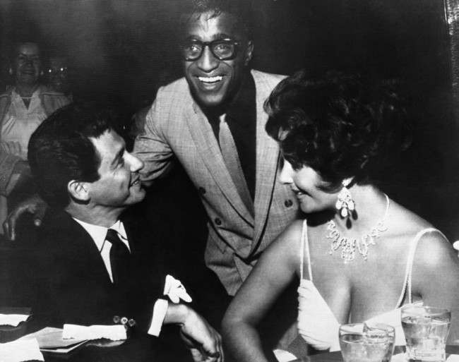 Elizabeth Taylor, right, and Eddie Fisher, left, discuss wedding plans with Sammy Davis, Jr. shortly before dawn at the Hotel Tropicana, April 2, 1959, Las Vegas, Nev. The actress and Fisher said where they will marry depends on what Debbie Reynolds Fishers ex-wife, says. If Miss Reynolds agrees to a quickie Nevada divorce, Liz and Eddie will wed here, otherwise Mexico.