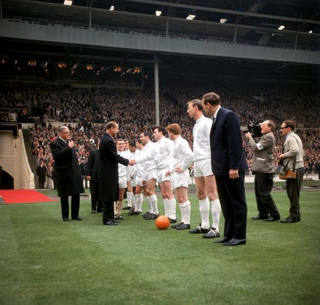 HRH The Duke of Edinburgh (second l) shakes hands with Leeds United's Jim Storrie (fourth r) as he is introduced to the players by Leeds captain Bobby Collins (third l). Awaiting their turn are Leeds United's Billy Bremner (third r), Jack Charlton (second r) and manager Don Revie (r)
