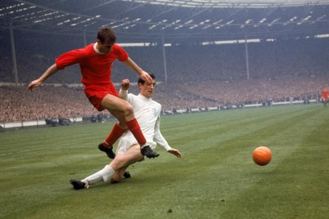 Leeds United's Norman Hunter (r) slides in too late to prevent Liverpool's Roger Hunt (l) firing the ball across