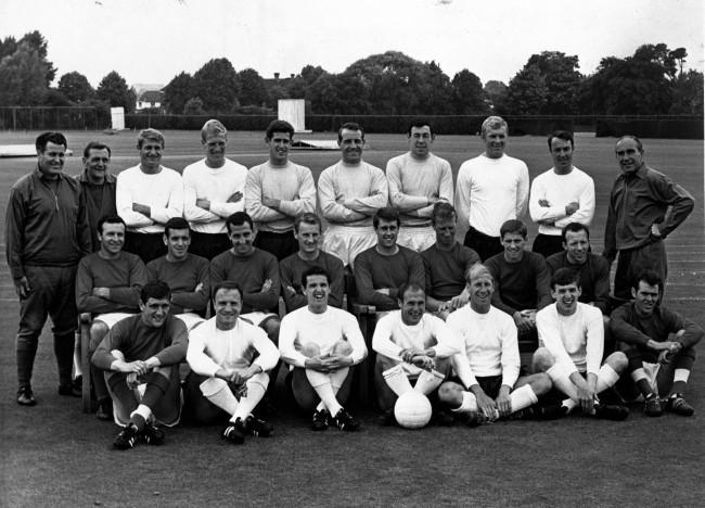 Members of the England World Cup soccer team pose at the training ground at Roehampton, England, June 22, 1966. From left to right, back row: Harold Shepherdson, Les Cocker, Roger Hunt, Ron Flowers, Peter Bonetti, Ron Springett, Gordon Banks, Bobby Moore, Jimmy Greaves and manager Alf Ramsey. Middle row: Jimmy Armfield, Ian Callaghan, Gerry Byrne, George Eastham, Geoff Hurst, Jackie Charlton, Alan Ball and Nobby Stiles. Front row: Norman Hunter, George Cohen, Terry Payne, Ray Wilson, Bobby Charlton, Martin Peters and John Connelly. (AP Photo) Ref #: PA.8306627  Date: 22/06/1966