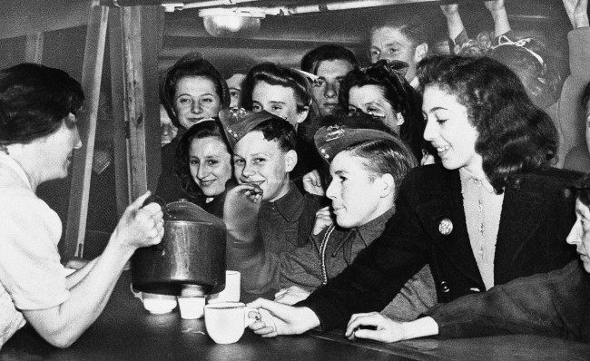 Young Londoners, in a shelter against Hitler?s robot bombs, crowd the canteen for refreshments, deep under the city of London, July 25, 1944. When completed, the shelters will provide sleeping accommodations for 40,000 persons.