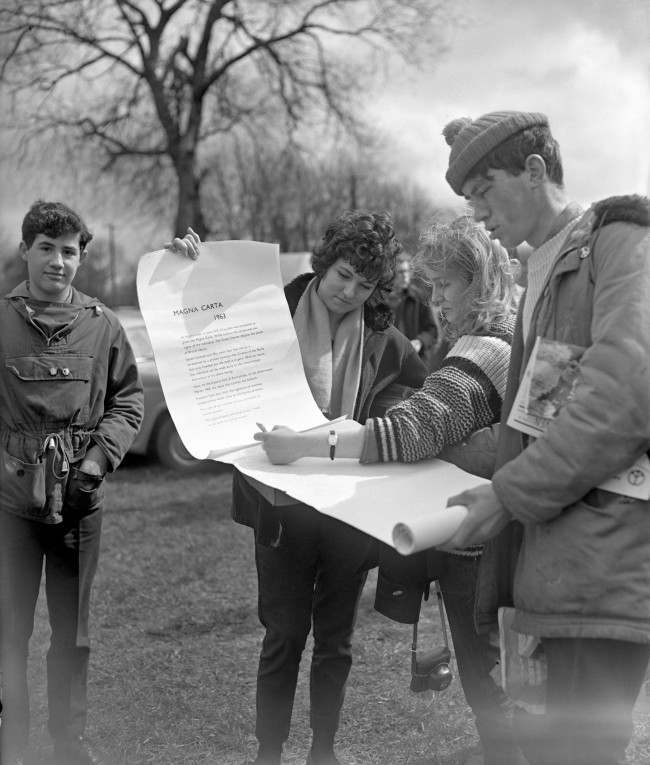 "Some of the marchers sign a ""Magna Carta 1963"" at Runnymede, on the site of the signing of the original Magna Carta 750 years ago. Ref #: PA.8520226 Date: 14/04/1963"