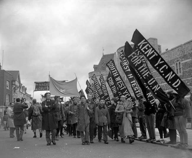 A group of campaign marchers from Hiroshima, Japan, pass Windsor Castle. Ref #: PA.8520232 Date: 14/04/1963
