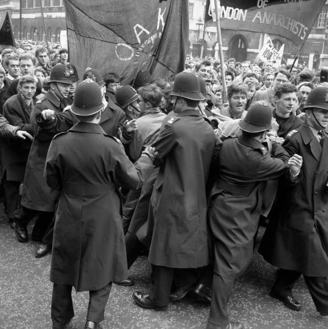 Police straining against a solid mass of people in an effort to control a contingent of Aldermaston to London marchers as they made their way to the final rally in Hyde Park. Ref #: PA.8520327 Date: 15/04/1963
