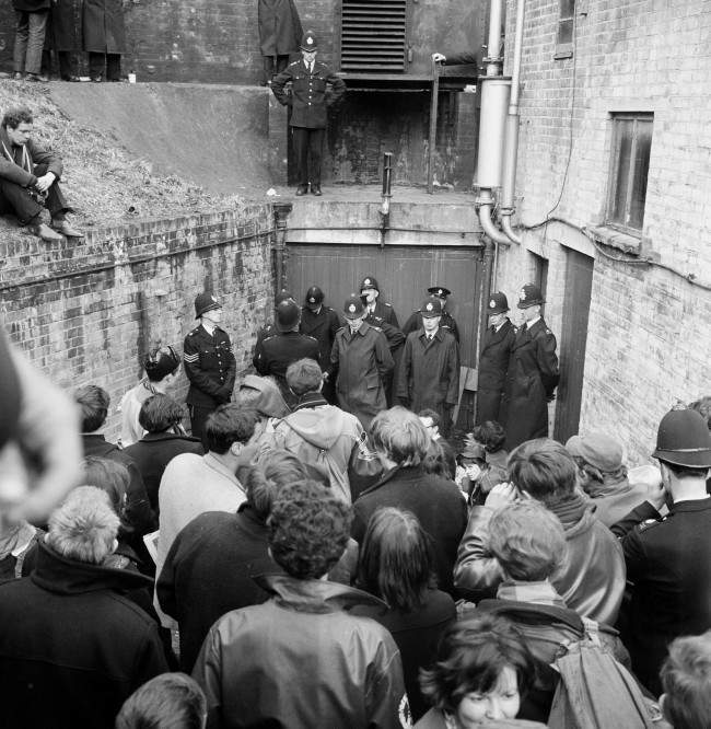 A double rank of policemen guards an entrance to a bunker type building in Berkshire, where nuclear disarmament demonstrators attempted to stage a protest. Ref #: PA.8520361 Date: 15/04/1963