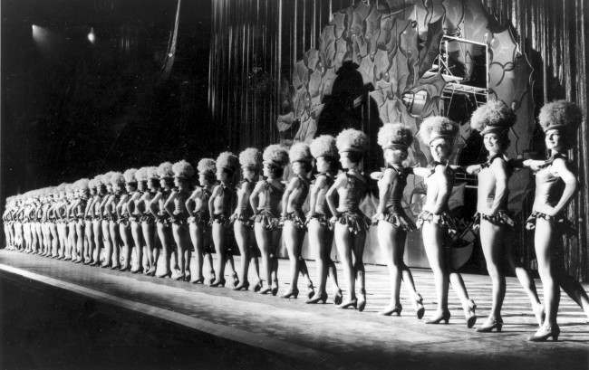 The Radio City Rockettes, 36 in total, are about to rehearse their precision 20-kick-a-minute routine for the annual Christmas Spectacular show at Radio City Music Hall in New York City, Dec. 13, 1962. The theater is celebrating its 30th anniversary.