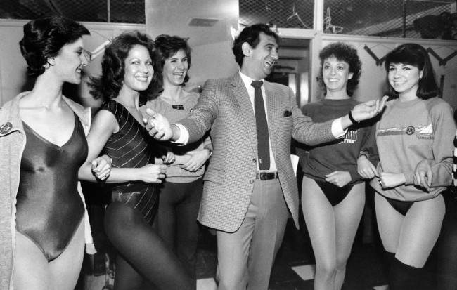 "Singer Placido Domingo shares a laugh with members of the Rockettes at New York's Radio City Music Hall, Feb. 27, 1984. The singer and dancers met while rehearsing for Channel Thirteen's ""Gala of Stars 1984."""