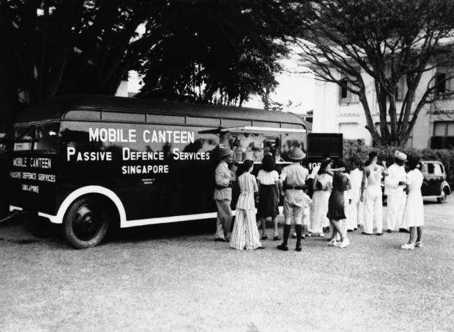 This mobile canteen carries food and refreshments throughout Singapore now under fierce Japanese attack shown Feb. 11, 1942. It is operated by European and Chinese girls as part of the passive defense services there.