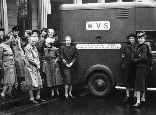A mobile canteen is presented in London by the Buffalo, N.Y., branch of the Aid to Britain organization on Jan. 4, 1943. With Women's Volunteer Service Workers present, Lady Iris Capell (right, in uniform) Vice Chairman of the W. V. S., accepted the canteen from Mrs. Logan Wright, Chairman of the Aid to Britain organization.