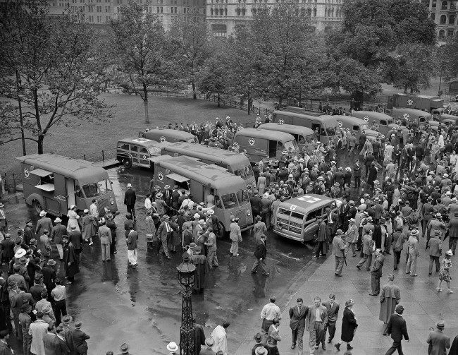 Crowds inspect the 14 mobile disaster units dedicated to the Red Cross in New York, June 27, 1942, by the Masons of New York state. This equipment is especially designed for use following an air raid. The mobile canteens are capable of serving 150 meals an hour. The Red Cross expects to have similar units for all the larger cities in the country. The vehicles were accepted for the Red Cross by Norman H. Davis, national chairman.
