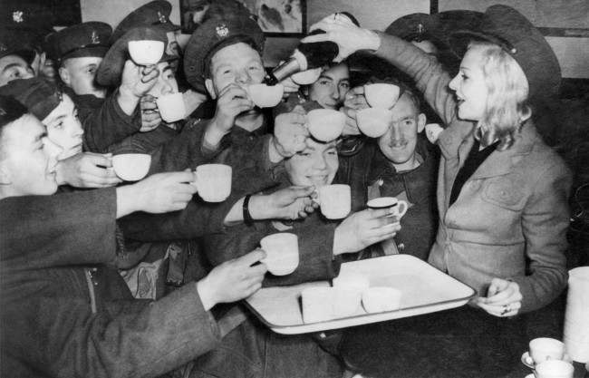 Miss Claire Luce, right, well known British Actress, served champagne to the British Tommies who flocked into the canteen she opened under the name of St. Peter's kitchen at St. Pancras station in London on Nov. 7, 1939. It is from this and other stations in London that the Tommies leave enroute to the fighting front in France.