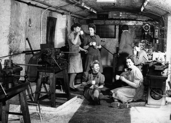 Time out for a cup of tea during a five-minute morning break in the underground factory in England April 11, 1944.