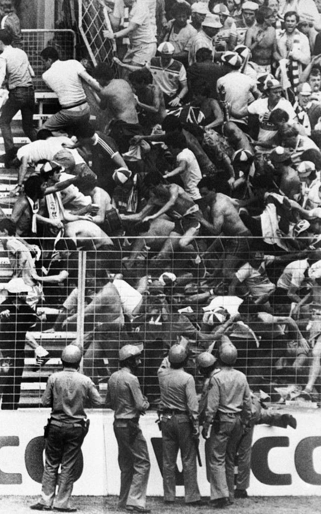 Spain Bilbao World Cup England vs France Riot Spanish riot police with batons look on as England football fans tumble over barriers during a minor disturbance with French fans at the World Cup Soccer match between England and France in Bilbao, Spain on June 6, 1982. England won the match 3-1. (Ap Photo/Str/Jacques Langevin) Date: 16/06/1982