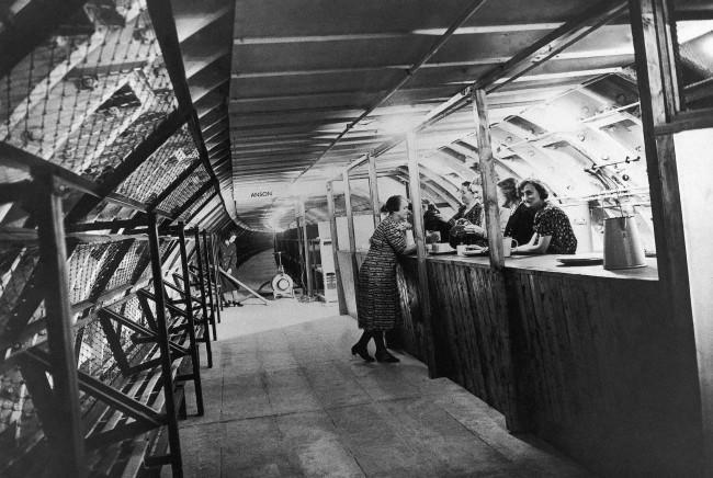 This is the canteen in one of London's new deep underground air raid shelters, Oct. 20, 1942. Note the line of bunks which are convertible into seats on the left wall.