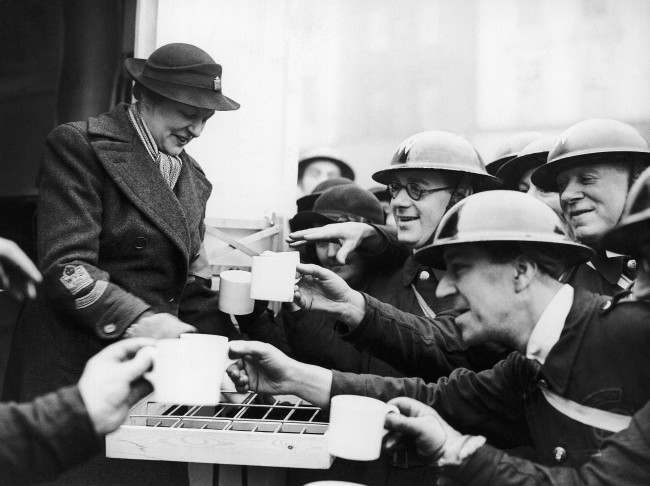 Mrs. Montagu Norman, the wife of the governor of the Bank of England, handing out tea to the A.R.P. workers after she had opened the canteen at Islington Town Hall, Jan. 15, 1940.