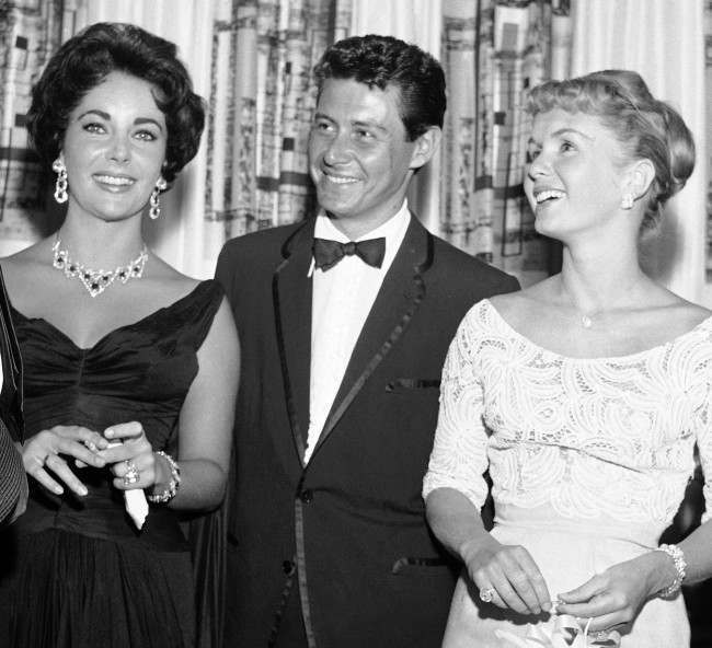 - Elizabeth Taylor, Eddie Fisher and Debbie Reynolds, from left to right, are shown attending the opening show starring Fisher at the Tropicana, in this June 19, 1958 file photo taken in Las Vegas, Nev.