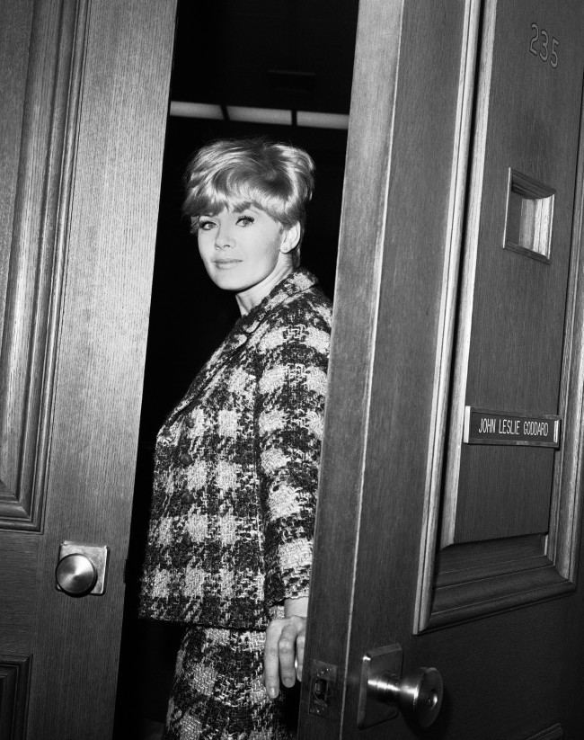 """Connie Stevens, 28, singer and actress, enters Superior Court in Los Angeles, Nov. 2, 1966 to obtain a default divorce decree from actor James Stacy, 29. She accused him of using """"abusive and vulgar language"""" and told of arguments in public. They were married three years ago and have no children."""