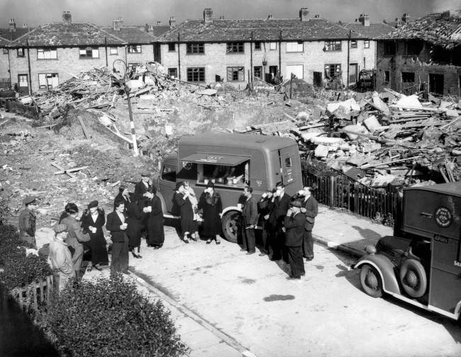 Americans who have answered Lord Woolton's appeal to London caterers for hot food and drink for air raid victims by giving fifty mobile canteens through the allied relief fund, have now decided to increase this fleet of mobile kitchens to 100 vehicles. The first of these mobile canteens started work in London on October 9. The new canteen giving warm food and drink to raid victims in one of London's bombed areas, Oct. 9, 1940.