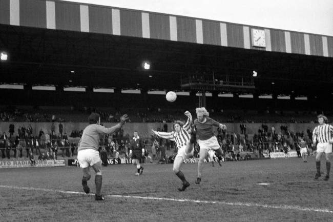 Everton's Alan Whittle (r) beats Stoke City's goalkeeper Gordon Banks (l) to score Everton's first goal of the night. Stoke City went on to win the match 3-2 in front of just over 5,000 fans.