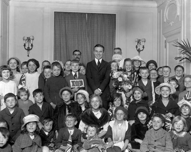 Charlie Chaplin poses with fifty boys and girls from Hoxton School. PA/PA Archive/Press Association Images