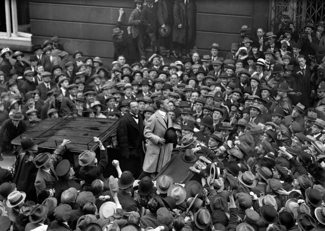 British star of the silent screen,Charlie Chaplin, addressing the crowd outside the Ritz Hotel, where he is staying. PA/PA Archive/Press Association Images