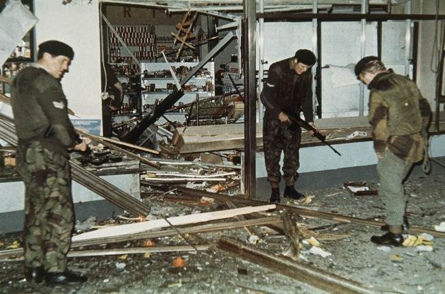 British troops sift through the ruins of a supermarket after a bomb exploded in Cavehill Road, Belfast, Northern Ireland in 1971.