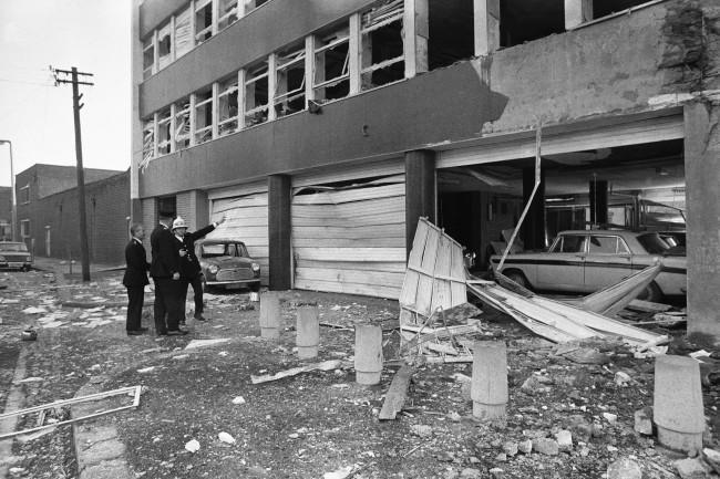 Security men examine the damage caused by a terrorist bomb detonated in the Youth Employment Office in Belfast, Northern Ireland on Nov. 2, 1971.