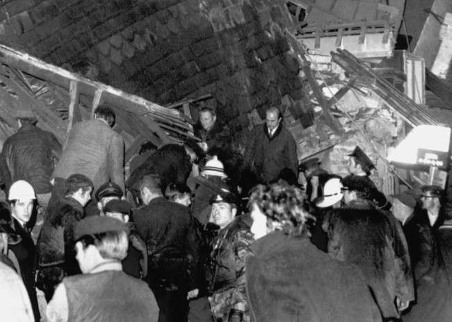 Rescuers search the wreckage of the Red Lion Bar in Belfast, Northern Ireland, where a terrorist bomb, killed two and injured over thirty persons on November 2, 1971.