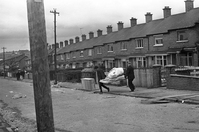 With the fear of being burnt out, Protestant householders move some of their belongings from a street in the Ardoyne area of Belfast, Northern Ireland on August 10, 1971.