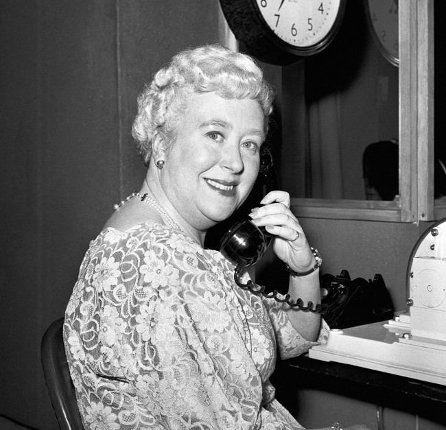 t's likely that a year from now, 100 million calls will have been answered by the 'Golden Voice' of Pat Simmons, 42 year old assistant supervisor at the Avenue Telephone Exchange. At Television House, Kingsway, London, she won the contest to find the voice for the GPO's new Speaking Clock, better known as TIM. Date: 12/12/1962