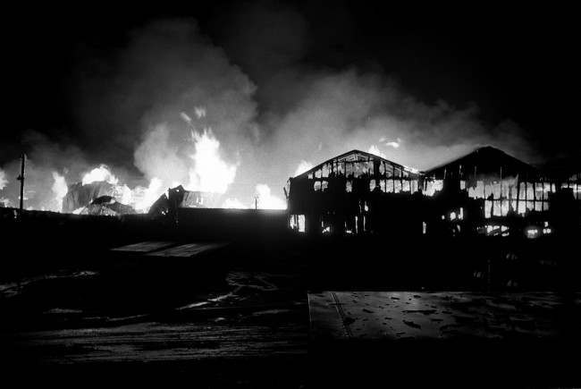 At the height of the blaze, flames leap from a 12-acre timber yard in Belfast's dockland. The fire raged for three hours before it was brought under control. Date: 10/02/1971